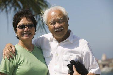 Senior couple with binoculars