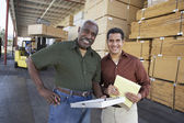 Photo Warehouse workers stocktaking