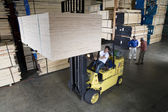Photo Manual worker operating a forklift truck