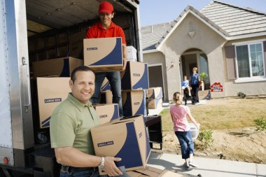 Family and worker unloading delivery van