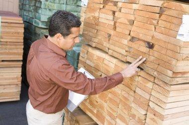 Supervisor stock taking in warehouse