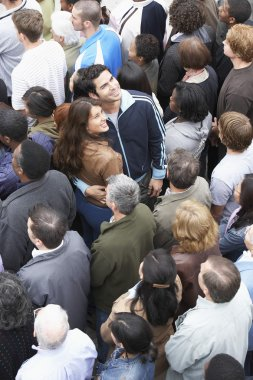 Couple in multiethnic crowd