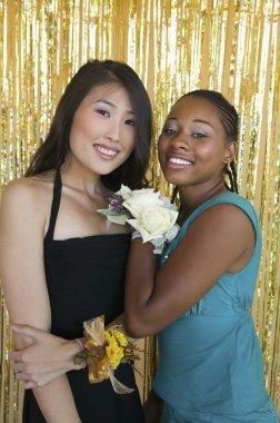 Teenager girls hugging at school dance