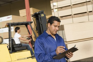 Supervisor and forklift truck driver