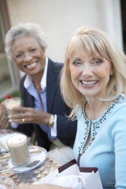 Smiling Women Having Coffee Drinks