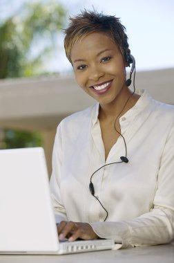 Woman on patio using laptop