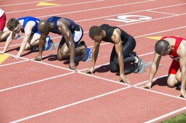 male athletics at starting block
