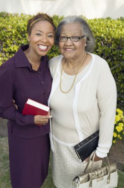 Daughter and Mother with Bibles