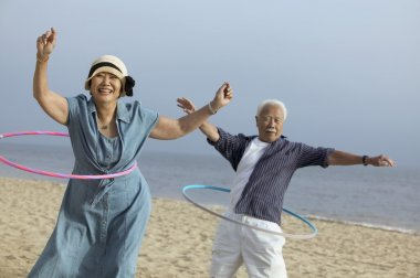 Couple with hula hoops