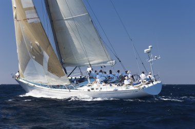 Racing Sailboat with Crew on Ocean