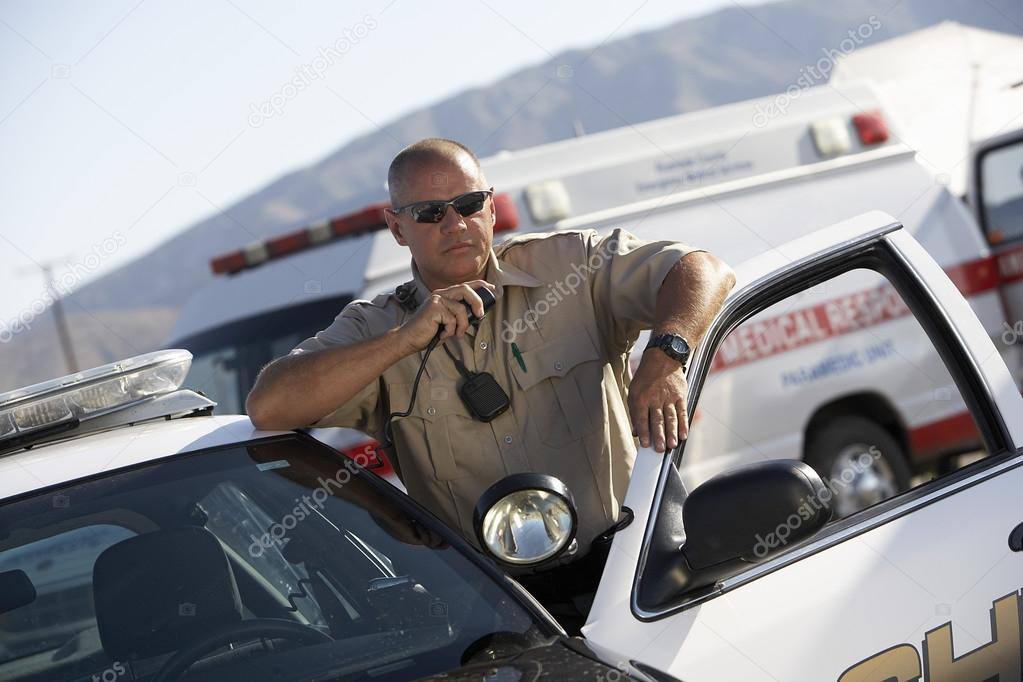 Police officer using two way radio