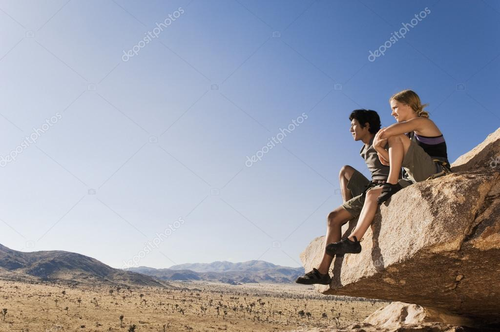 climbers sitting on rock