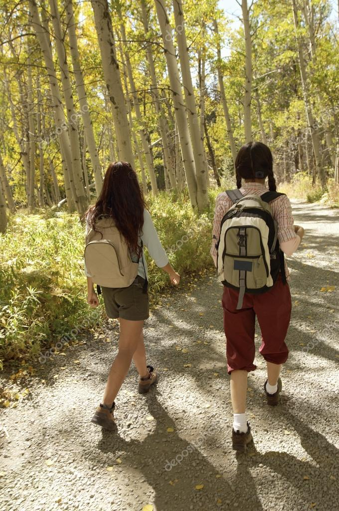 Two female hikers walking