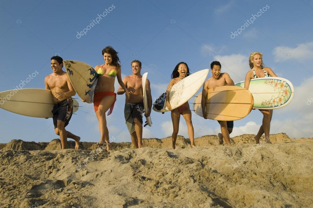friends with surfboards running