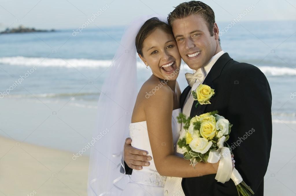 Happy bride and groom embracing