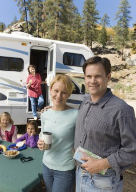 Couple and family outside RV