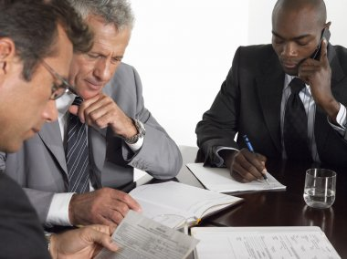 Businessmen at conference table