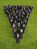 Business people standing in triangle formation