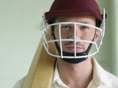 Cricket player wearing helmet