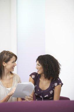 Cheerful  businesswomen talking