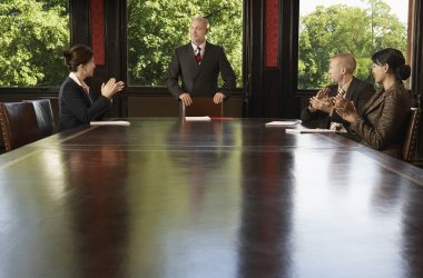 Businesspeople around boardroom table