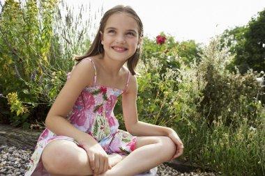 Girl Sitting in Meadow