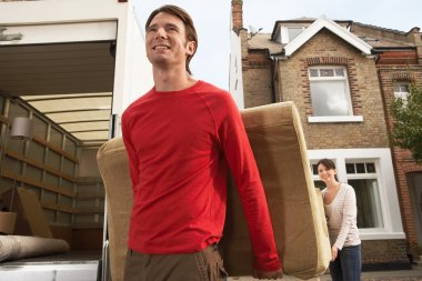 Moving Couple Carrying Sofa
