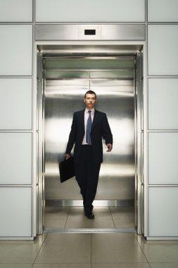 Businessman Exiting Elevator