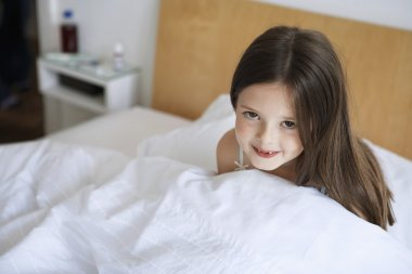 Girl sitting up in bed