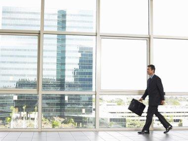 Businessman walking in office building
