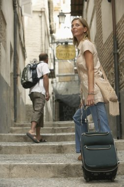 Woman tourist with Luggage