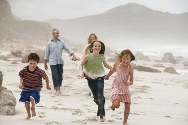 Running children on beach