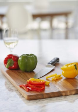 bell peppers on chopping board