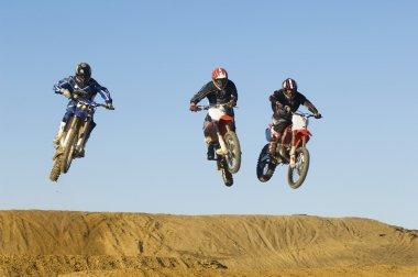Motocross Racers in mid-air