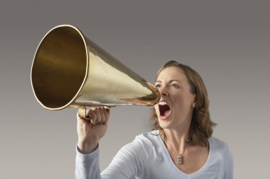 Angry woman shouting through megaphone