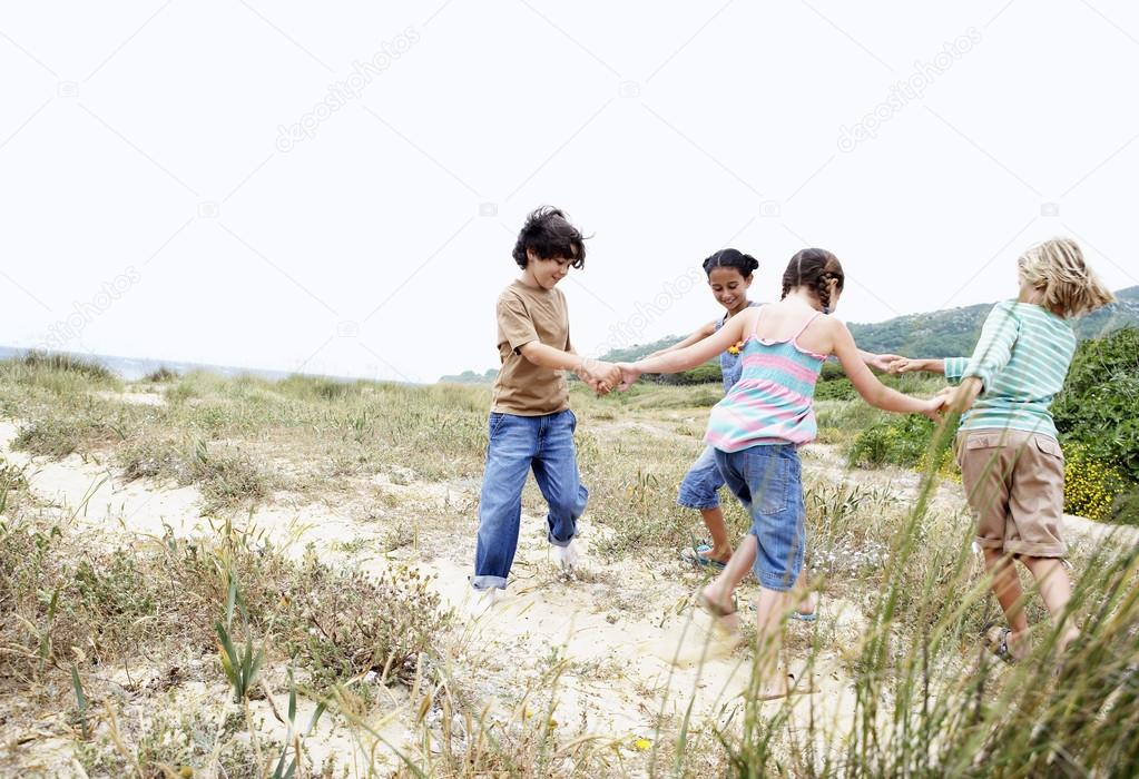 Children playing ring around the rosy
