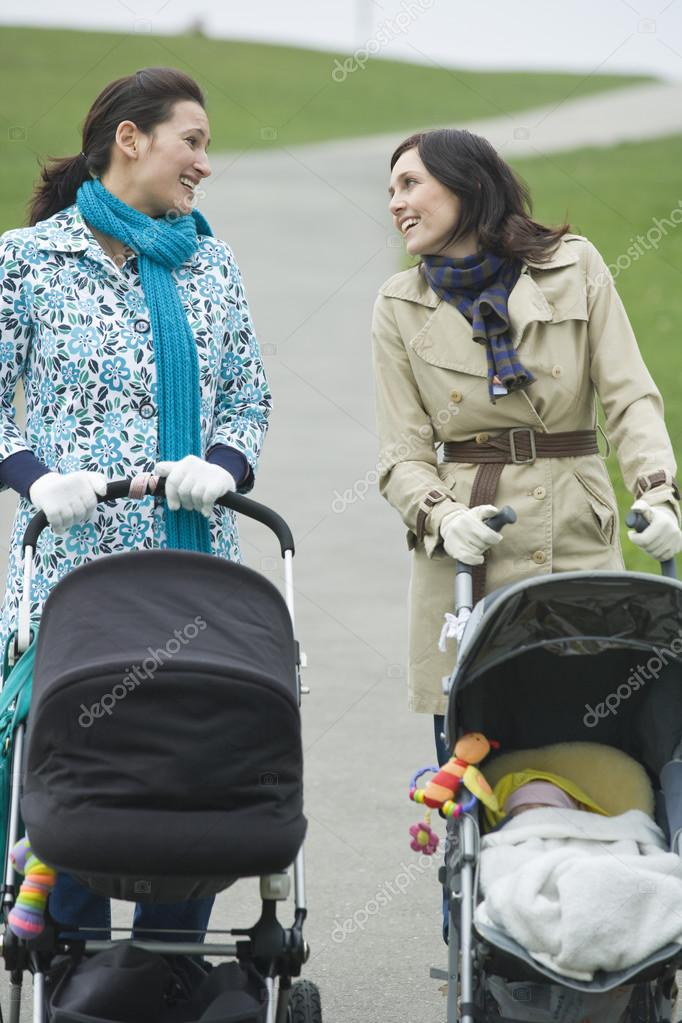 Mothers with strollers in park