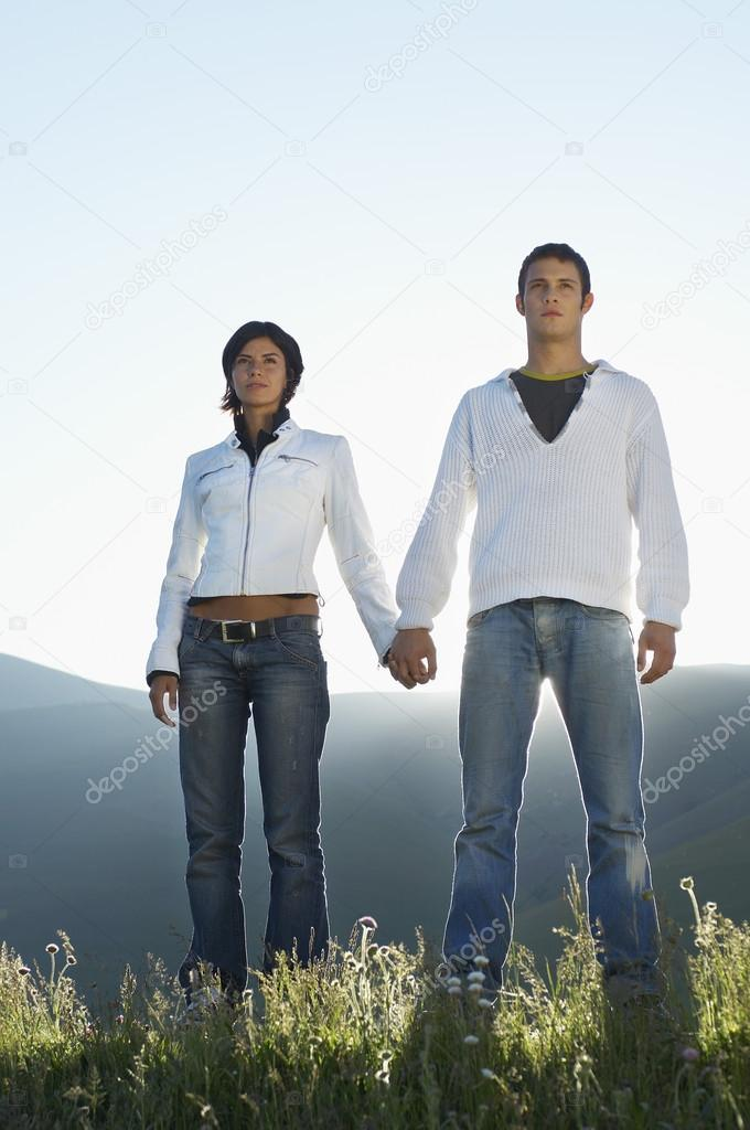 Couple in mountain field