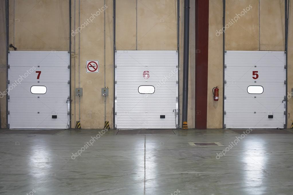 Loading Dock Doors in warehouse u2014 Stock Photo & Loading Dock Doors in warehouse u2014 Stock Photo © londondeposit #33826201