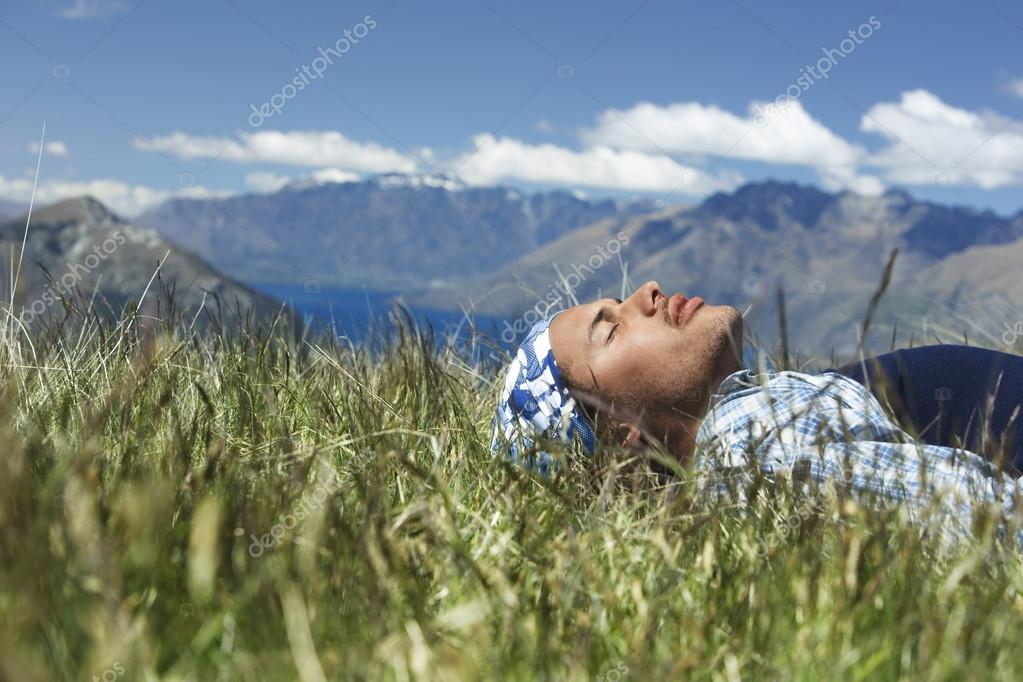 Man lying in field