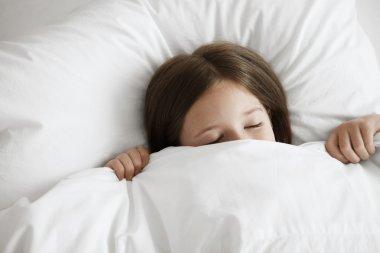 Little girl in bed