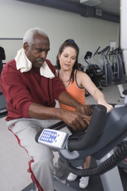 Trainer Working with Senior Man
