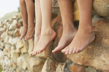 barefoot children legs in row