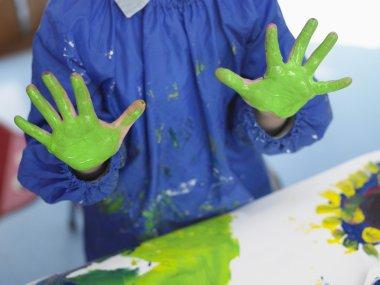 Boy fingerpainting in art class