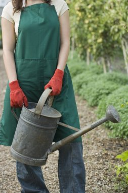 Woman Holding Watering Can