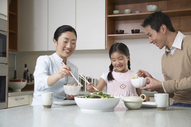 Couple and daughter eating a meal