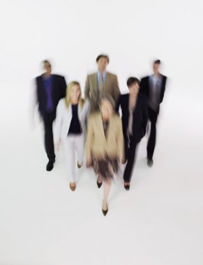 Businesspeople walking blurred effect