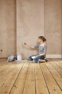 Woman Sitting on Floor with Color Swatch
