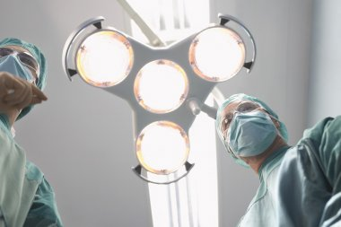 Physicians in operating theatre