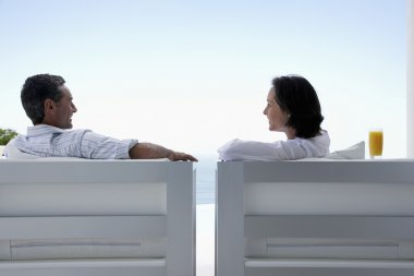 Couple Sitting at Beach